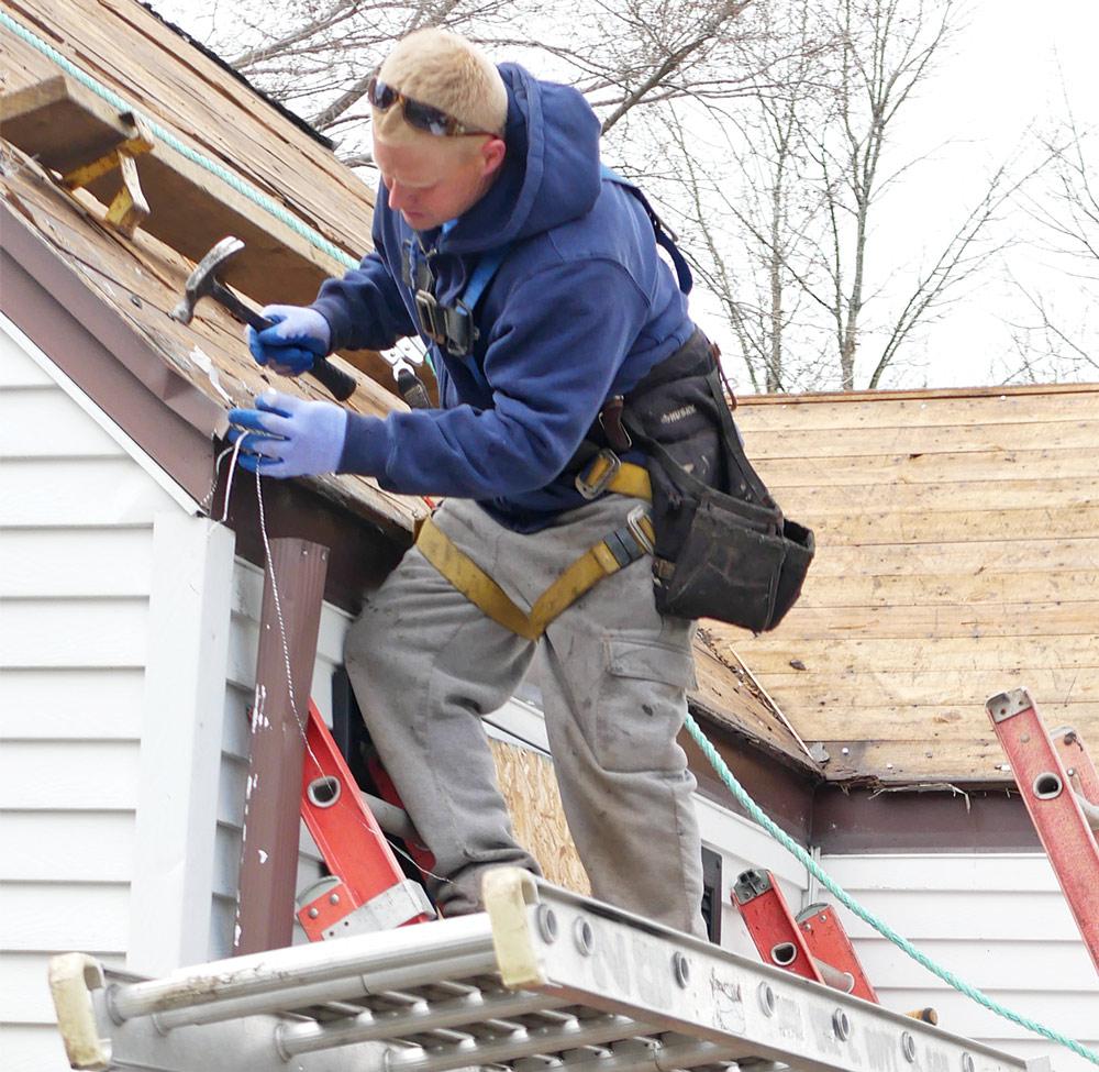 man repairing roof